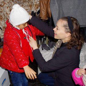 Megan Dressing a Refugee Child