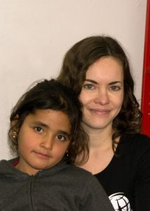 Megan with a refugee child in Greece